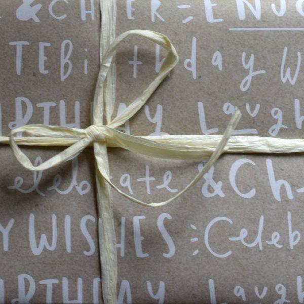 Birthday wishes writing kraft wrap with rafia ribbon