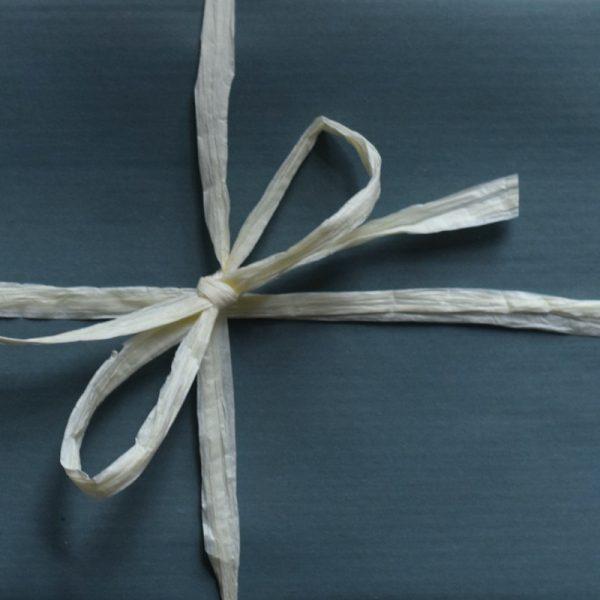 Teal kraft wrap with rafia ribbon